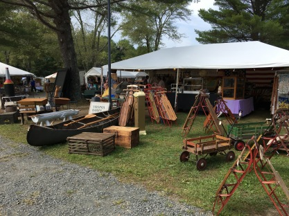 Lots of sleds, a canoe, and old wagons at Brimfield