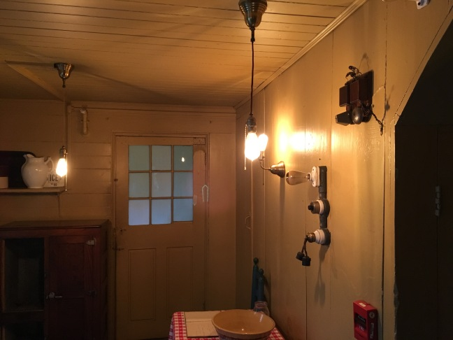 Wall of lighting and cloth-covered wire at Wayside: Home of Authors, Concord, MA